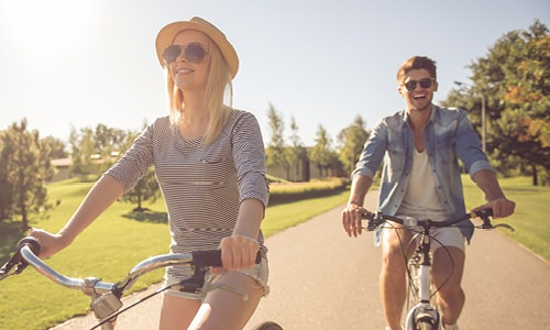 couple biking through a park